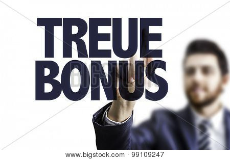 Business man pointing the text: Loyalty Bonus (in German)