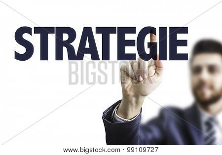 Business man pointing the text: Strategy (in German)