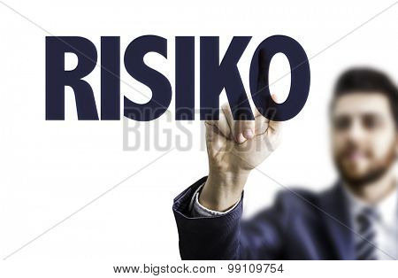 Business man pointing the text: Risk (in German)