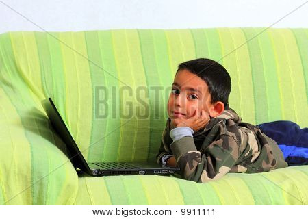 Smiling Child With Laptop