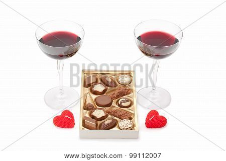 Wine Glasses With Wine, Chocolate And Candles