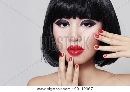 Portrait of young beautiful asian girl with stylish bob haircut and red lipstick