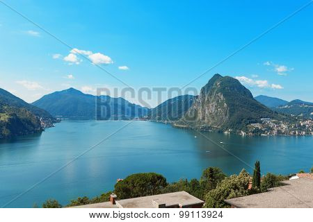 panoramic view of Lake Lugano in a summer day