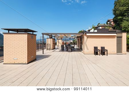 Architecture, wide empty terrace of a penthouse, sun day