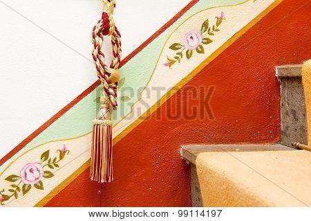 Tassel On Red Diagonal Design