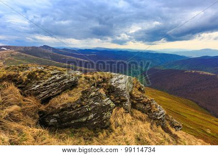 Landscape with old rock over valley in Carpathian mountains