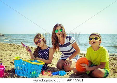 Family Mother Daughter Son Having Fun On Beach.
