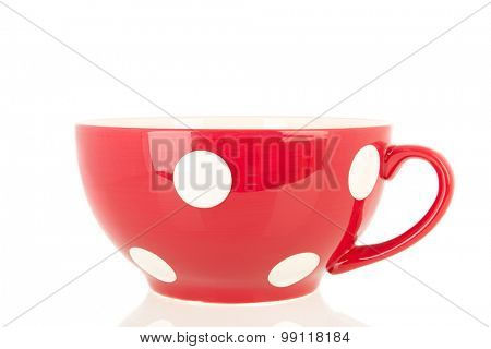 Big red cup with white dots isolated over white background