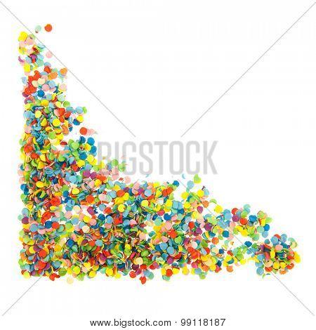 Colorful paper confetti corner isolated over white background