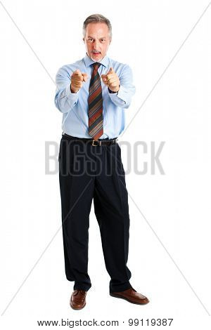 Smiling businessman isolated on white pointing at you