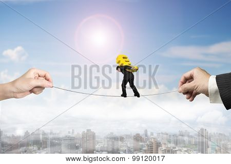 Businessman Carrying Euro Sign Balancing Tightrope With Hands Holding