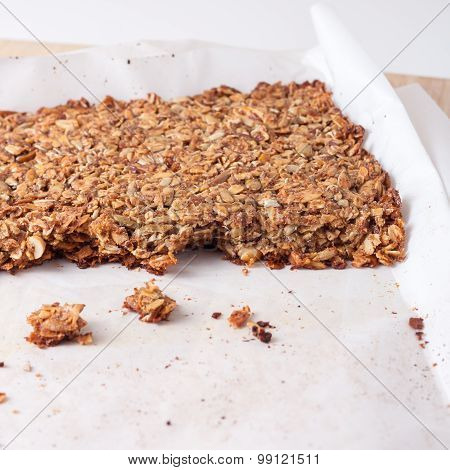 fresh home made granola bars made with coconut oil, nuts and seeds  on a baking sheet