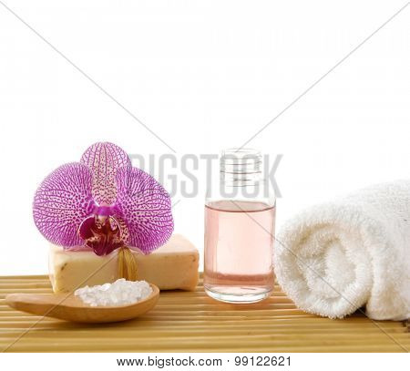 Spa resort -soap with orchid ,salt in spoon ,and towel ,oil on mat