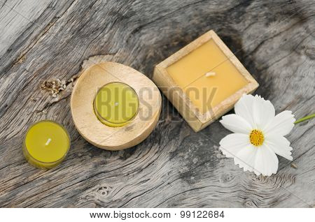gerbera,with three candle on old wood