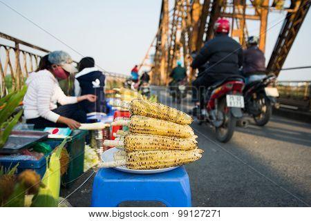 Street vendor on Long Bien bridge, Hanoi, Vietnam