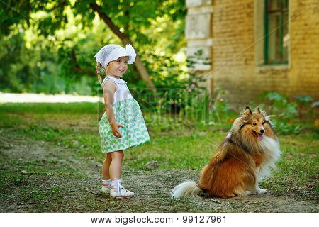 Little Girl And Dog.