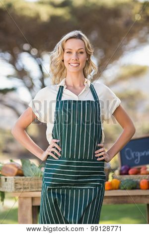 Portrait of a smiling farmer woman with hands on hips