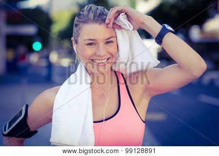 A beautiful athlete resting with a towel on a sunny day