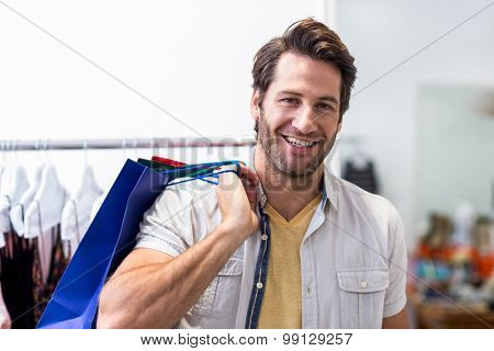 Portrait of smiling man with shopping bags