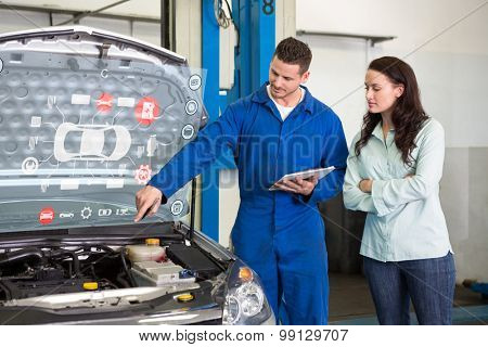 Engineering interface against mechanic showing customer the problem with car