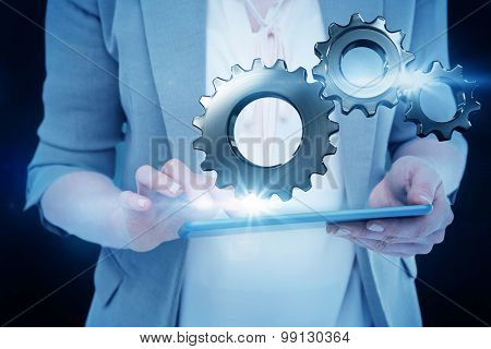 Close up of woman using tablet against blue background with vignette