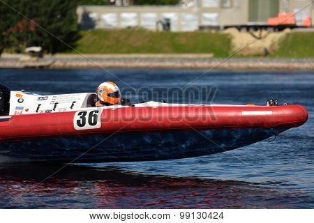 ST. PETERSBURG, RUSSIA - AUGUST 15, 2015: I. Pylaev of Russia competes in the River marathon Oreshek Fortress race. This international motorboat competitions is held since 2003