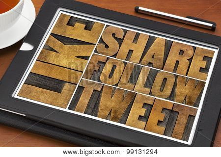 like, share, tweet, follow words-- social media and networking concept - text in letterpress wood printing blocks on a digital tablet with a cup of coffee