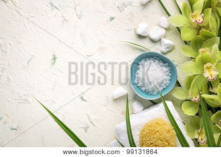 Spa still life with towel,sponge,salt and orchid