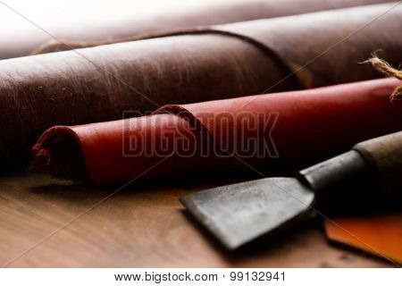 Leather craft. Work table of leathersmith. shallow depth of field.
