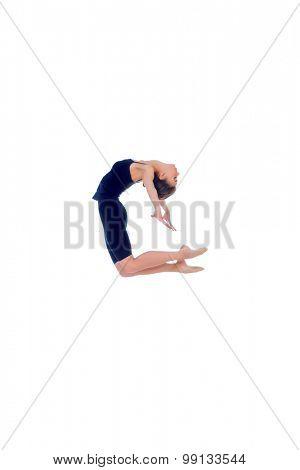 Beautiful graceful ballet dancer in black ballet leotard posing at studio. Jump, movement. Art concept. Isolated over white.
