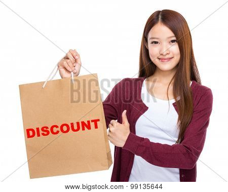 Woman with shopping bag and thumb up for showing a word discount