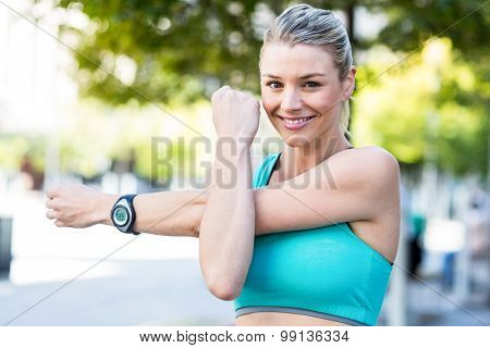 A beautiful woman stretching her arms on a sunny day
