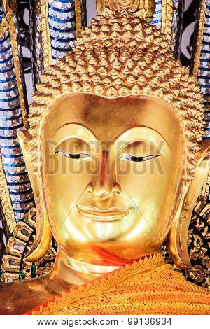 A Statue Of Gold Buddha In Wat Po, Bangkok, Thailand