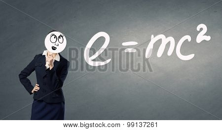 Businesswoman hiding her face behind paper mask