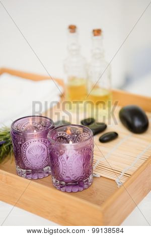 Close up massage tray with candles and stones