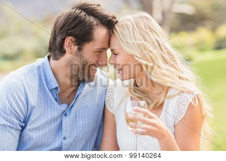 Front view of a cute couple on date giving head to head