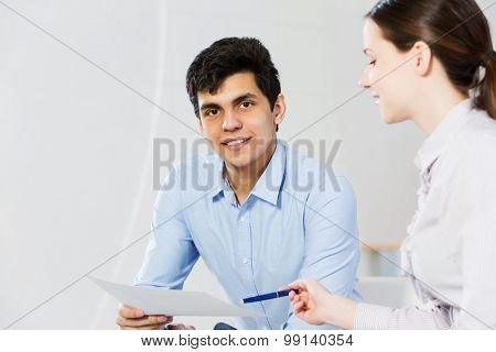 Two students working in cooperation and having discussion
