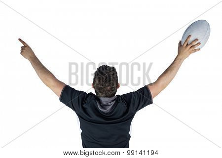 Back turned rugby player gesturing victory on a white background