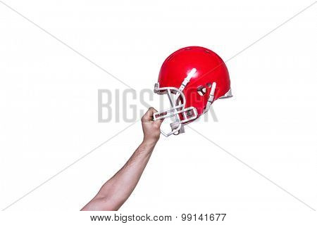 American football player handing his helmet on a white background