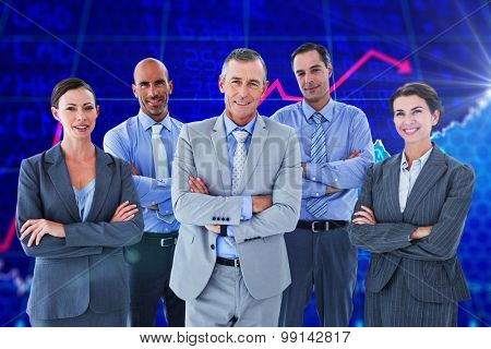 Business team working happily together on laptop against stocks and shares