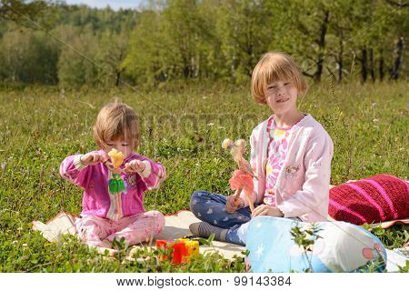 Two Girls Play With Dolls
