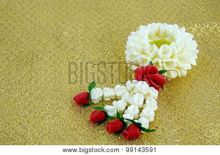 Thai Traditional Style Flowers Assortment On Golden Fabric Background.