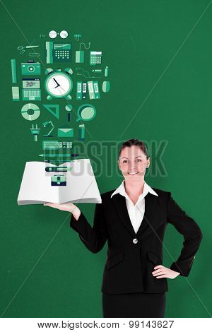 Businesswoman showing a book against green