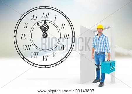 Full length portrait of repairman with toolbox against open door in sky