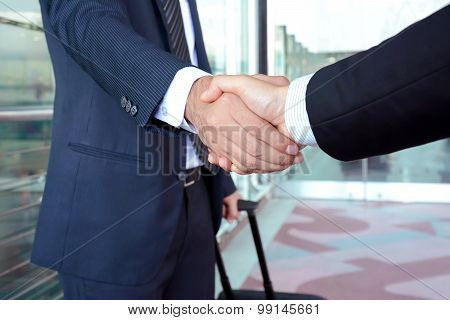 Handshake Of Businessmen At The Airport - Business Travel Concept