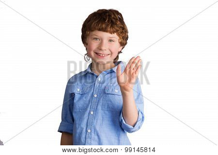 Handsome smiling boy waving with his hand. Isolated on white background