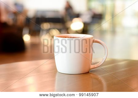 Coffee Cup On The Table In Coffee Shop