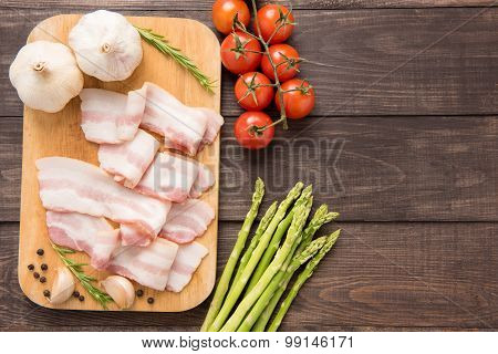 Smoked Bacon Slices On A Wooden Table. Top View