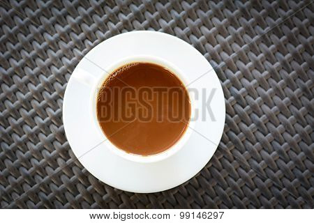 Coffee Cup On Brown Wicker Table