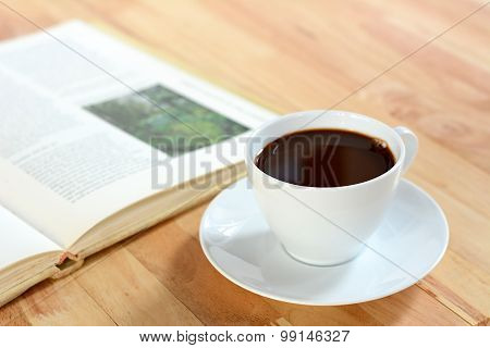 Coffee Cup With Book On Wood Table